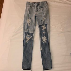 American Eagle skinny jeans with rips and patches